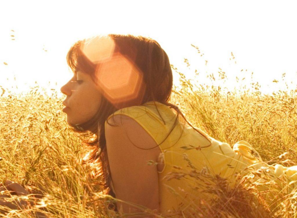 girl-lying-in-a-wheat-field-summer